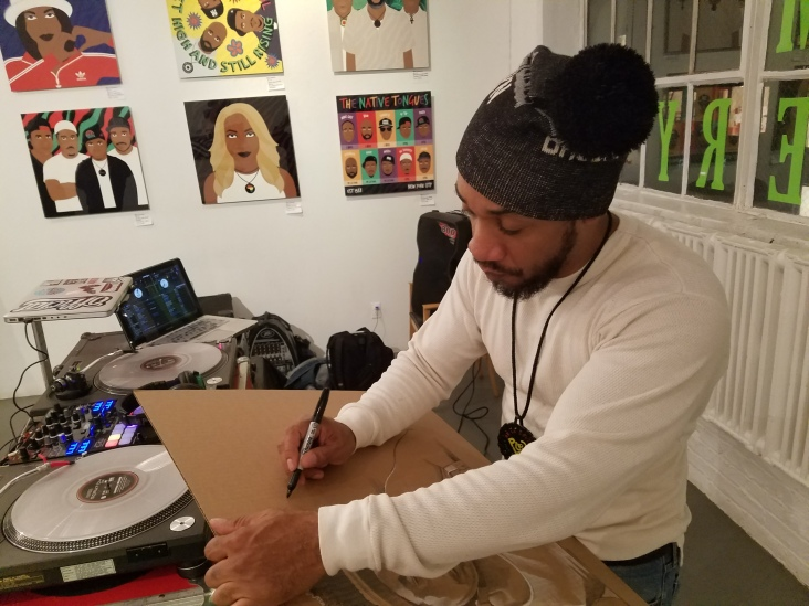 DJ Prince Paul tagging the new corrugated cardboard portrait